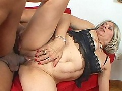 Mature bitch enjoys black cock